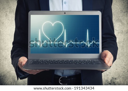 laptop with ekg on the screen  - stock photo