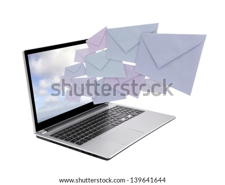 Laptop with envelopes coming out of the screen - stock photo