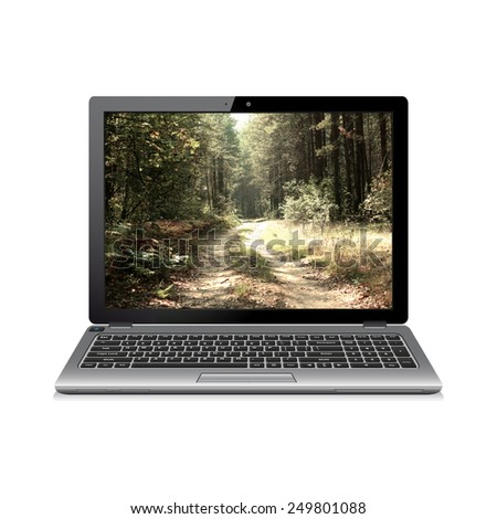 Laptop with forest road on screen - stock photo