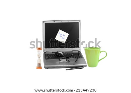 """Laptop with """"Gone for Day"""" post it adhesive note next to hourglass and coffee mug isolated on white background - stock photo"""