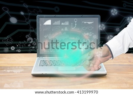laptop with graph on wooden table,Creative thinking drawing business success strategy plan ideas on wooden table background
