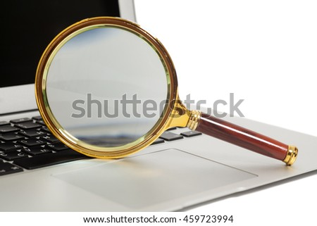 Laptop With Magnifying Glass isolated on white - stock photo