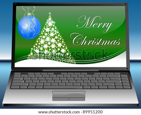 Laptop with Merry Christmas card - stock photo
