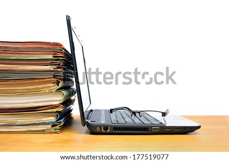 Laptop with multicolored office ring binders