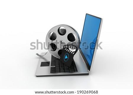 Laptop with reel - stock photo