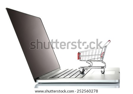 Laptop with small shopping cart isolated on white background - stock photo