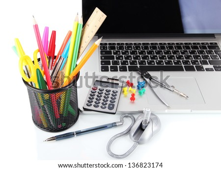 Laptop with stationery isolated on white