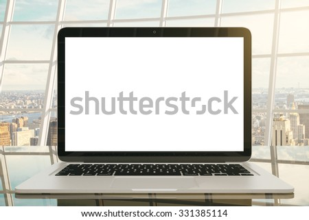Laptop with white screen in a modern office, mock up - stock photo