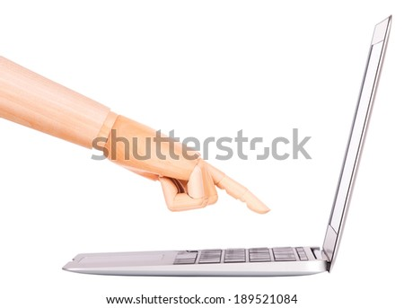 laptop with wooden hand isolated on white background - stock photo