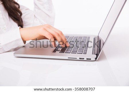 Laptop woman. Portrait of Hands of Business Woman   using laptop computer pc. Isolated on white background.