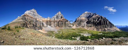 Larch Valley, Eiffel Mountain (l), Pinnacle (c), and Temple Mountain (r) Sentinel Pass - between Pinnacle and Temple Mountain Lake Louise, Banff National Park, Alberta, Canada - stock photo