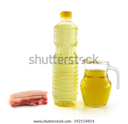 lard oil in a plastic bottle and jar on white background - stock photo