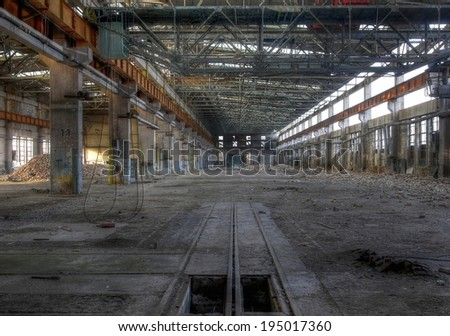 Large abandoned warehouse with an old floating crane
