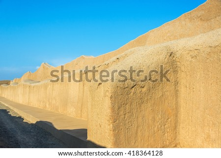 Large adobe wall in the ruins of Chan Chan in Trujillo, Peru