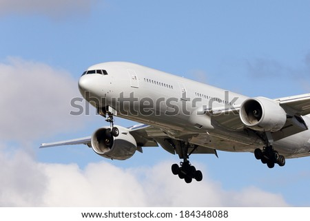 Large airliner on approach to land - stock photo