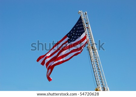 Large american flag hanging from Roseburg Fire Truck 1353 at the All American Home Town Fireworks celebration in Roseburg Oregon's Stewart Park, July 4th. - stock photo