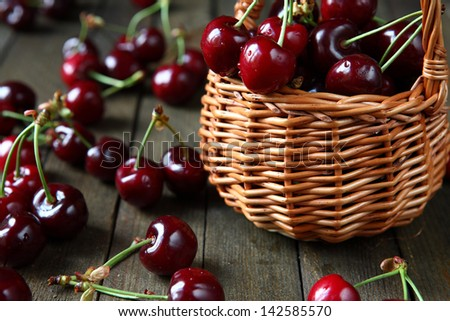 large and juicy ripe cherries in a basket, fresh fruits - stock photo