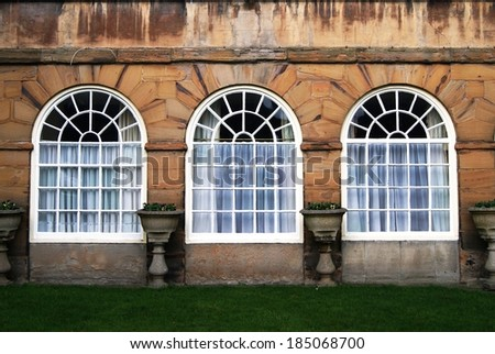 Large and open victorian age windows with planters in between. Durham, United Kingdom - stock photo