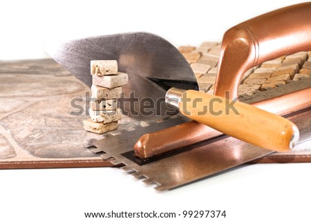 Large and small ceramic tiles and tool builder - stock photo