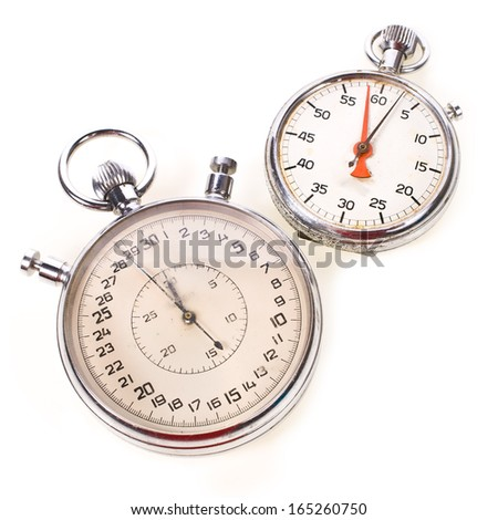 large and small hand-held stopwatches old scratched isolated on white background - stock photo