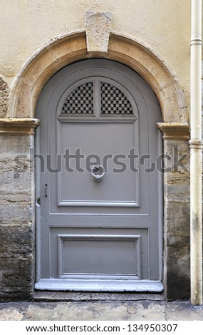 Large and stately wooden doors by the Vieux Lyon, France