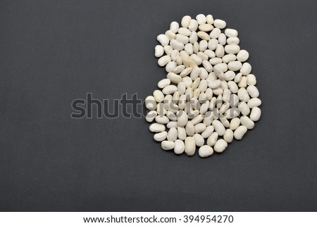 Large bean made from white beans on black background. Food vegan, vegetarian. Healthy food - stock photo
