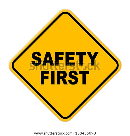 Large beveled yellow safety first road sign on white background - stock photo