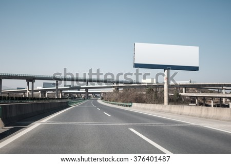 large billboards near the highway transportation hub
