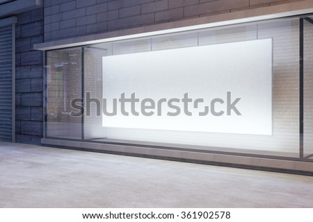 Large blank banner in a shop window at night, mock up 3D Render - stock photo