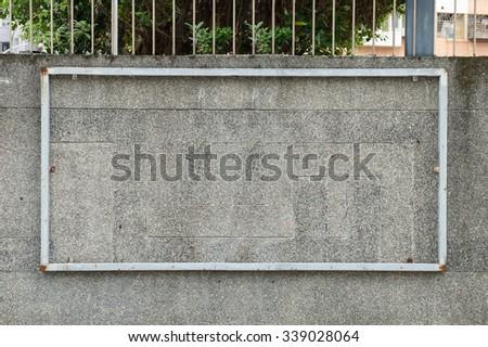 Large blank billboard on a street wall - stock photo