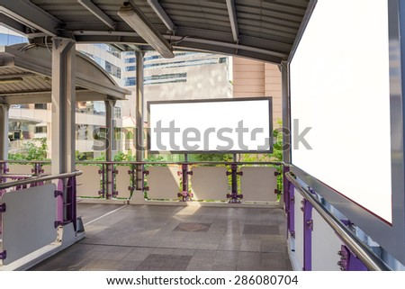 large blank billboard on overpass with city view background - stock photo