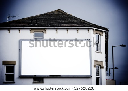 Large blank billboard on side of building - stock photo