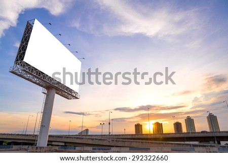 large Blank billboard ready for new advertisement with sunset. - stock photo
