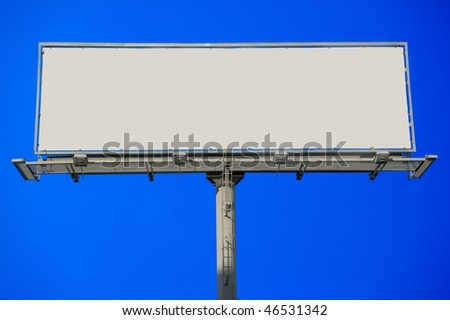 Large blank commercial billboard against cloudy sky - stock photo