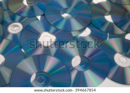 Large blue dvd discs background Cd ou dvd background - stock photo