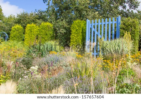 large blue gate out of garden - stock photo