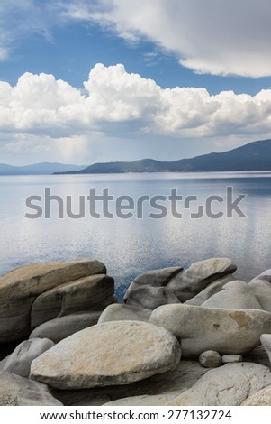 large boulders on the north/east shore of Lake Tahoe shot on a cloudy morning - stock photo