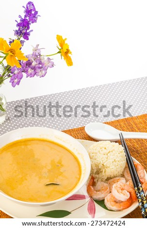 Large bowl of Thai Coconut Soup (Tom Kha Phak) served with steamed rice and shrimp.  Bamboo design on Oriental Platter with chopsticks.  Vertical with copy space. - stock photo