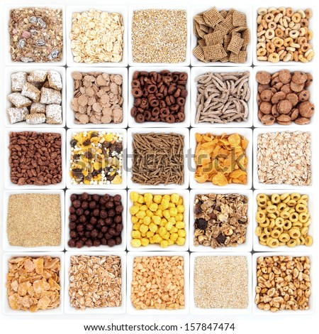 Large breakfast cereal selection in white square bowls forming a patchwork. - stock photo