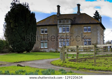 Large British traditional Farmhouse in the countryside near Swindon - stock photo