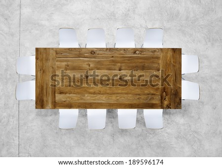 Large Brown Meeting Table with Twelve Chairs - stock photo