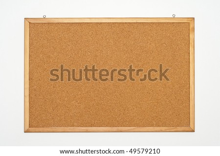 Large brown noteboard with a blank note