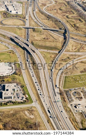 Large buildings next to flyovers and intersections of roads. - stock photo