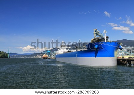 Large bulk carrier in the seaport of Vancouver - stock photo