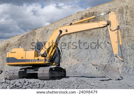 Large Bulldozer Excavator With Rocks - stock photo