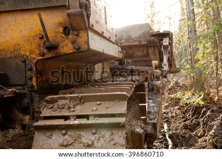 large bulldozer pulling my truck out of the mud