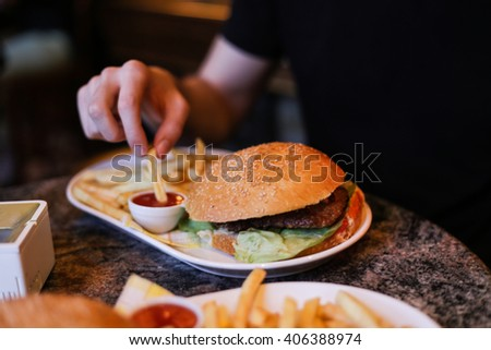 Large burger in a restaurant