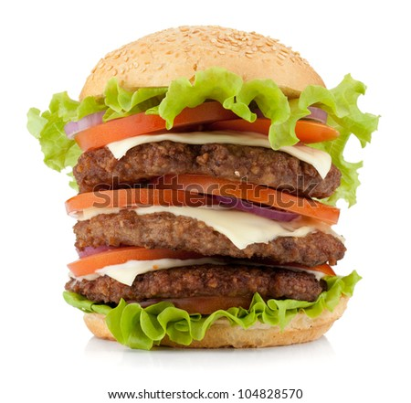 Large burger with beef, cheese, onion and tomatoes. Isolated on white background - stock photo