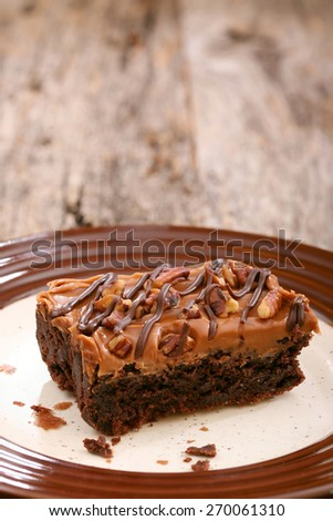 Large cake chocolate brownie on a plate using a wooden background