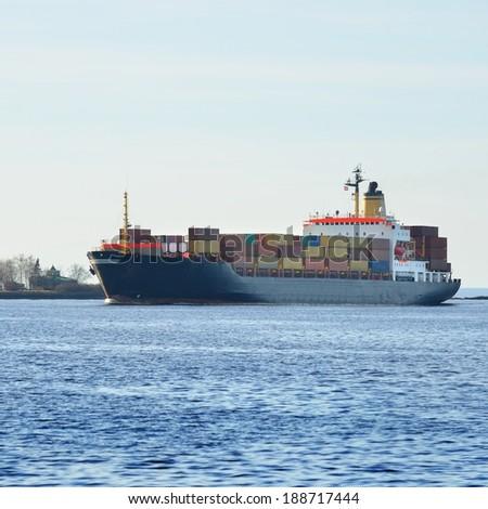 Large cargo container ship sailing. Riga, Latvia - stock photo